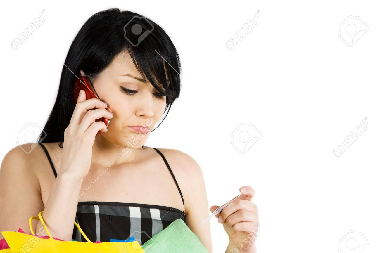 A shopping woman calling her credit card company Stock Photo - 2476000