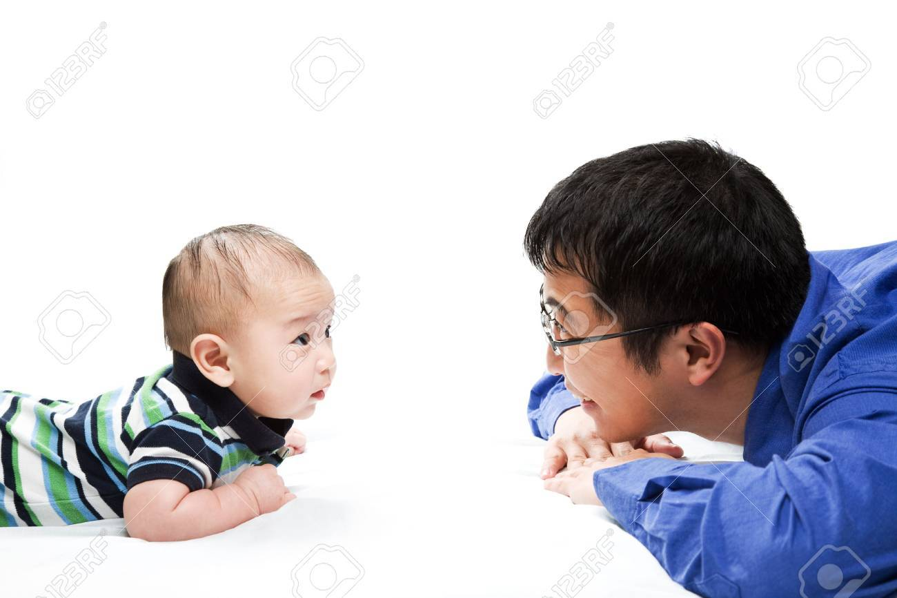 A shot of an asian father playing with his son Stock Photo - 2820359