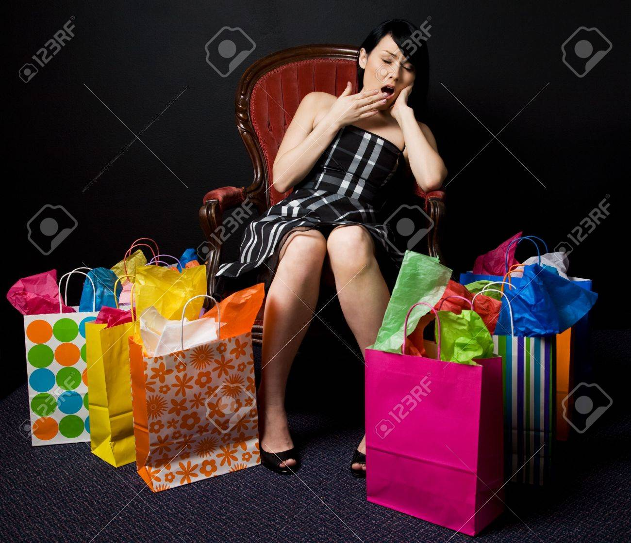 A shot of a tired and exhausted beautiful woman after shopping Stock Photo - 2894286