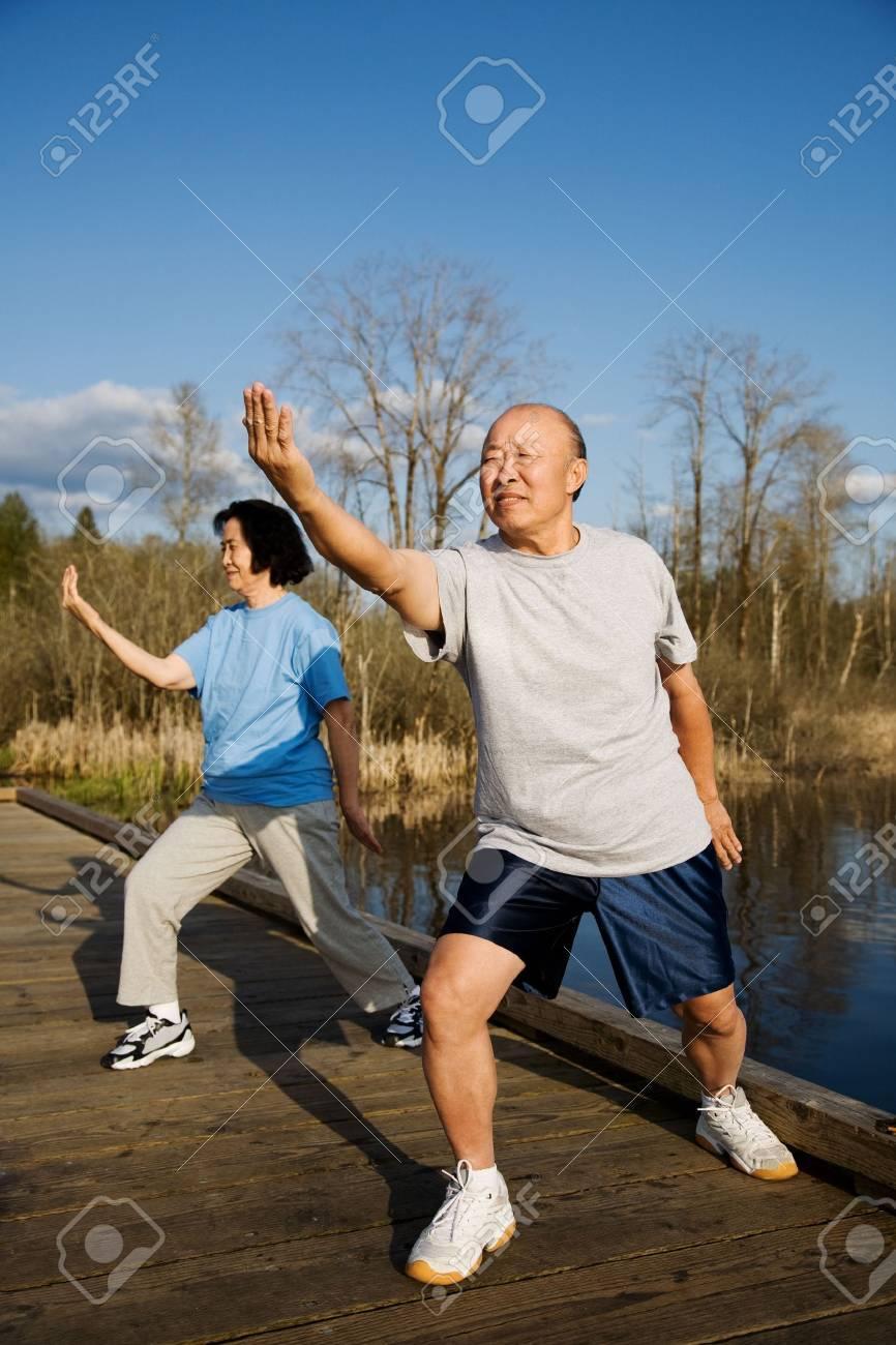 A shot of a senior couple practicing tai-chi exercise Stock Photo - 2954487