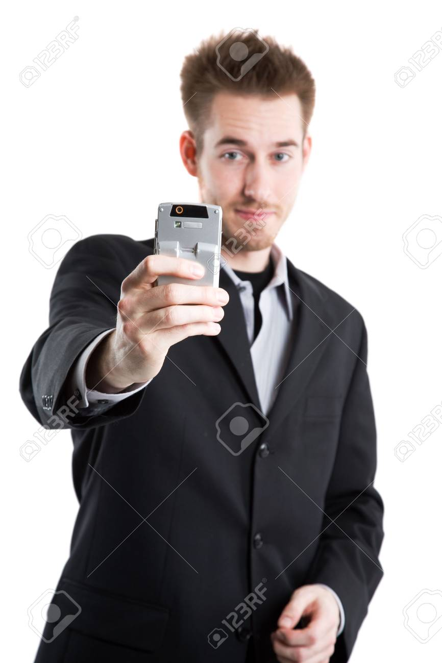An isolated shot of a caucasian businessman taking picture with his camera phone Stock Photo - 3146577