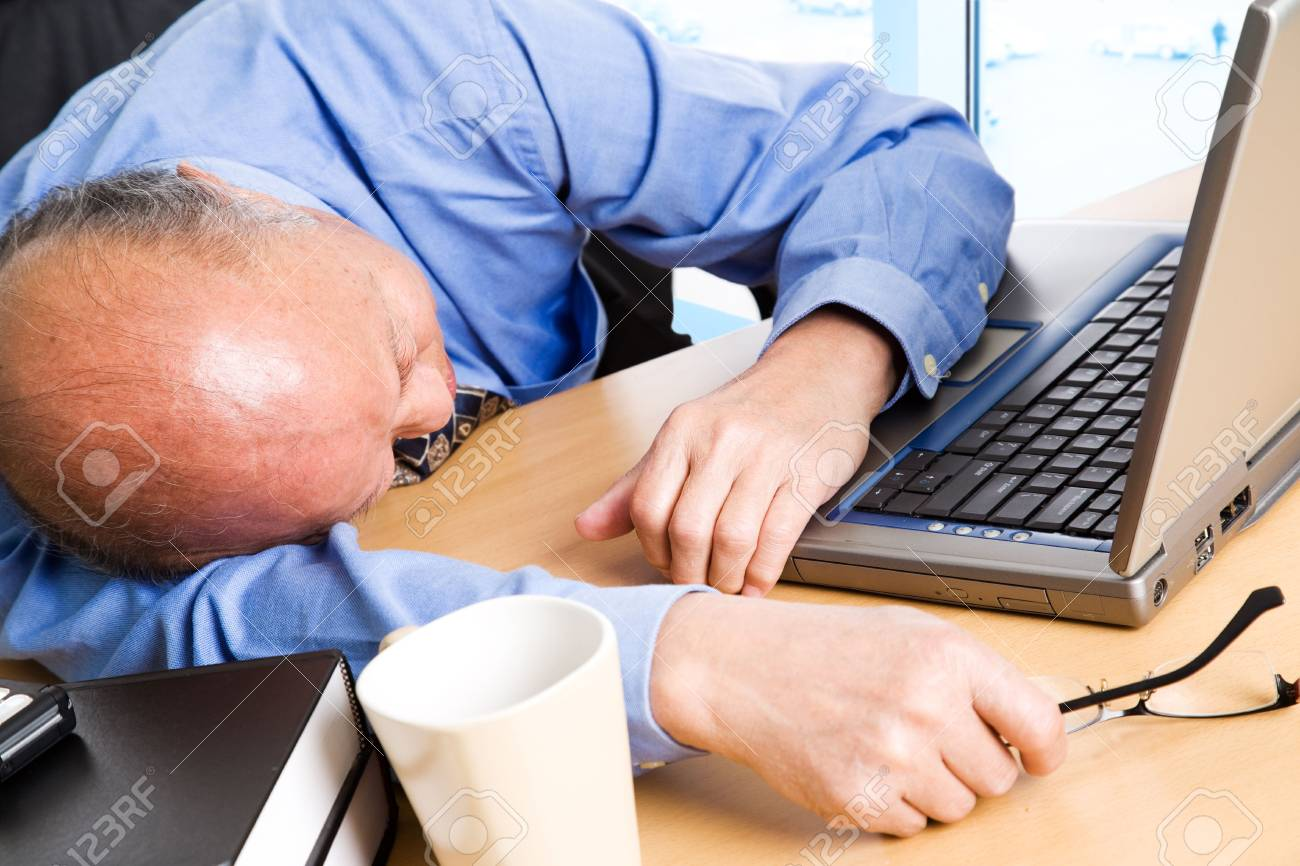 A shot of a senior asian businessman taking a nap in the office Stock Photo - 3234206