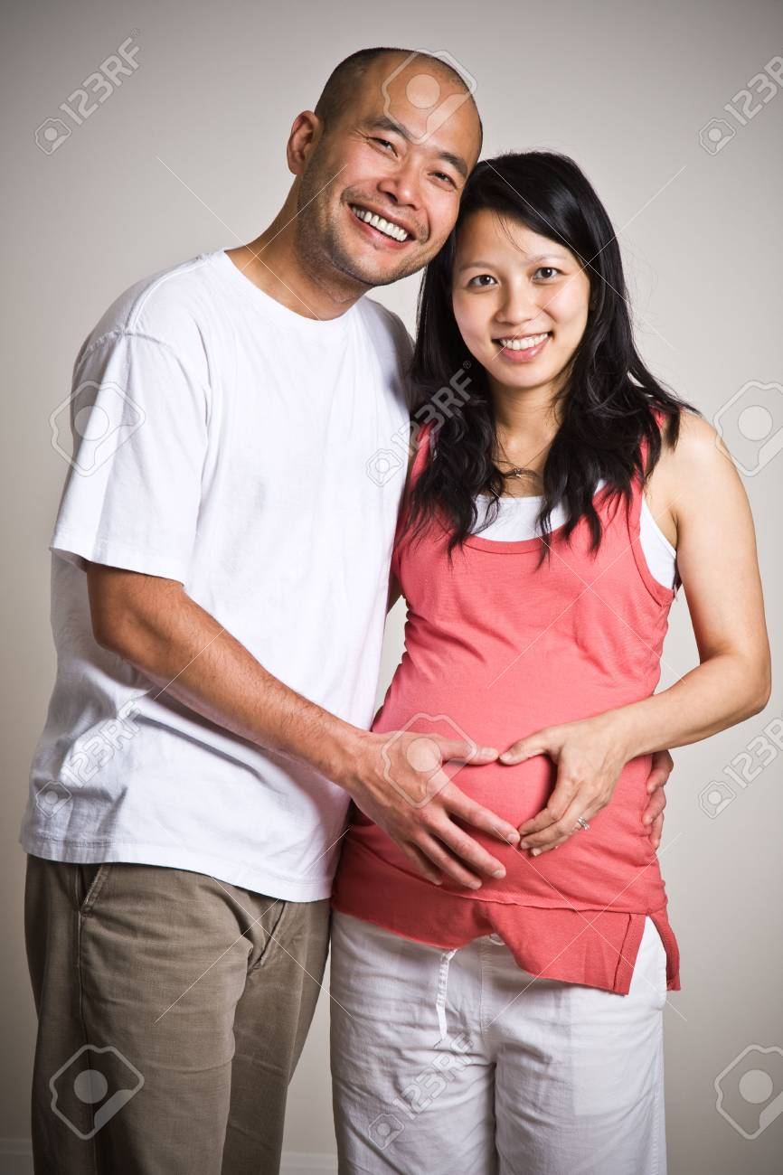 A happy pregnant asian couple expecting their Stock Photo - 3566220