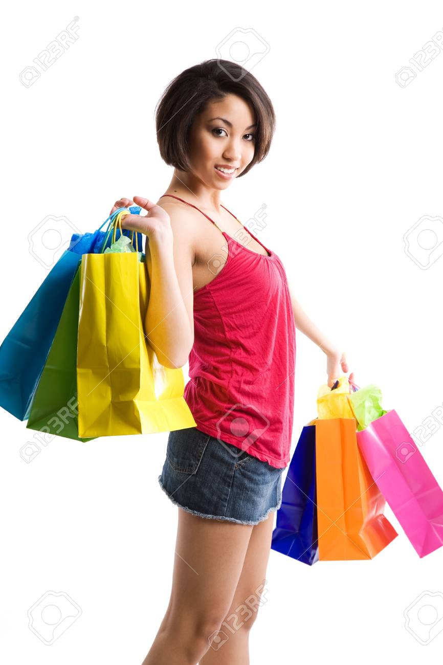 An isolated shot of a black woman carrying shopping bags Stock Photo - 3616563