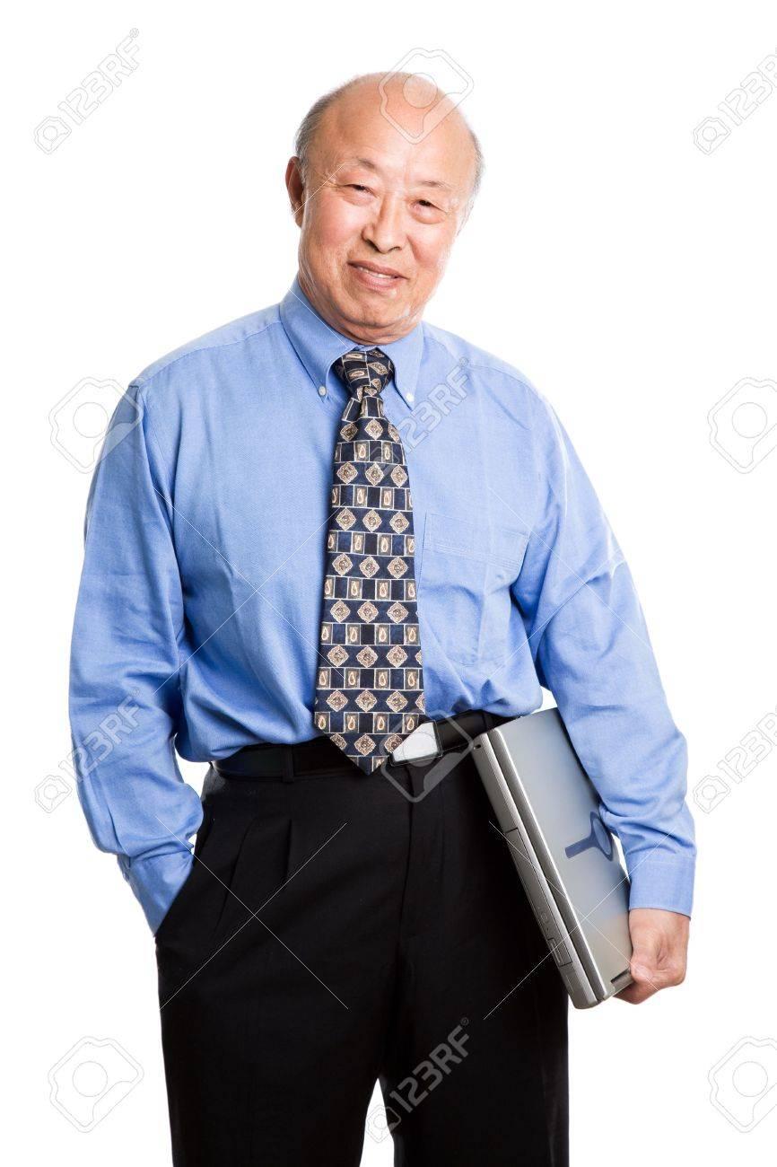 A senior asian businessman holding a laptop Stock Photo - 3675226