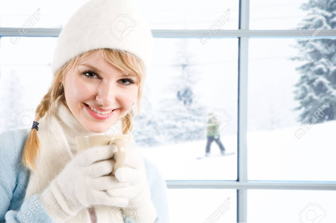 A beautiful caucasian girl drinking hot coffee at a ski resort Stock Photo - 3753637