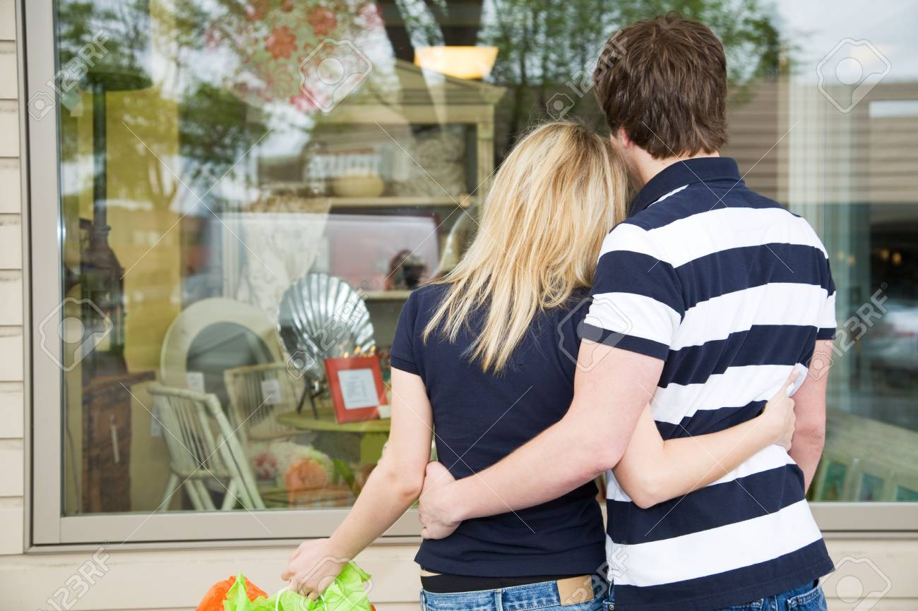 A young shopping caucasian couple looking into a store Stock Photo - 3775565