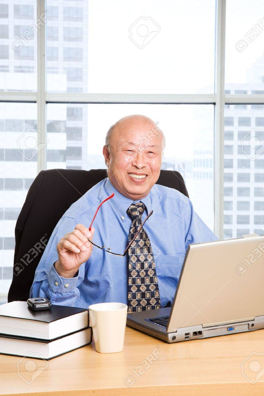 a senior asian businessman working in the office stock photo a senior asian businessman working in the office stock photo 3805171