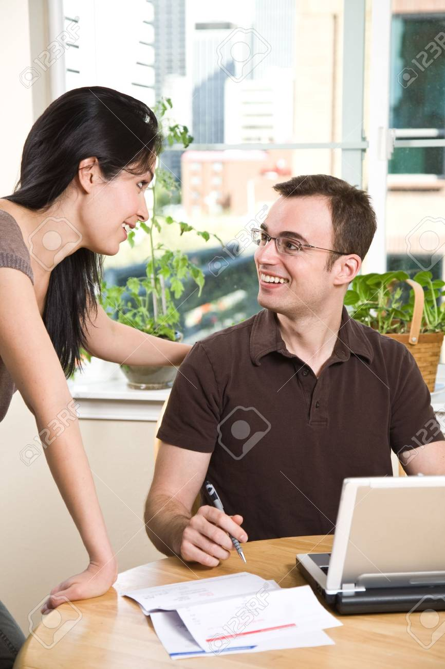 A happy couple paying bills by using online banking at home Stock Photo - 4843707