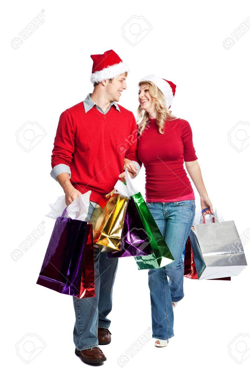 Caucasian couple doing christmas shopping and carrying shopping bags Stock Photo - 5528338