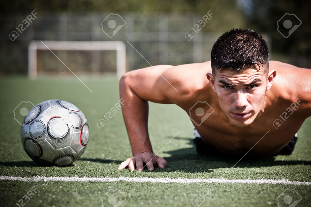 A shot of a hispanic soccer or football player doing a push-up Stock Photo - 5614508