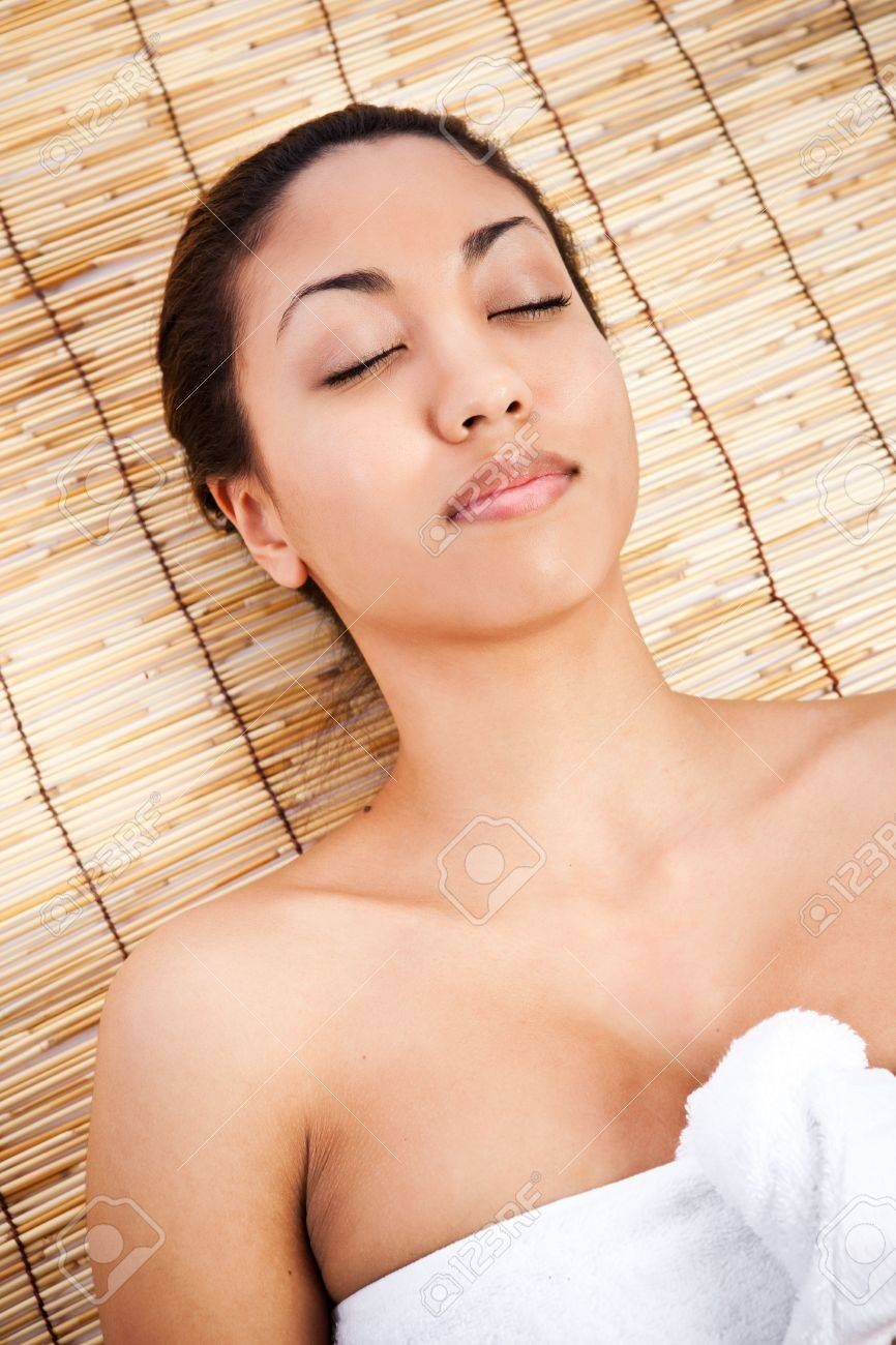 A shot of a black woman lying down at a spa Stock Photo - 6271543