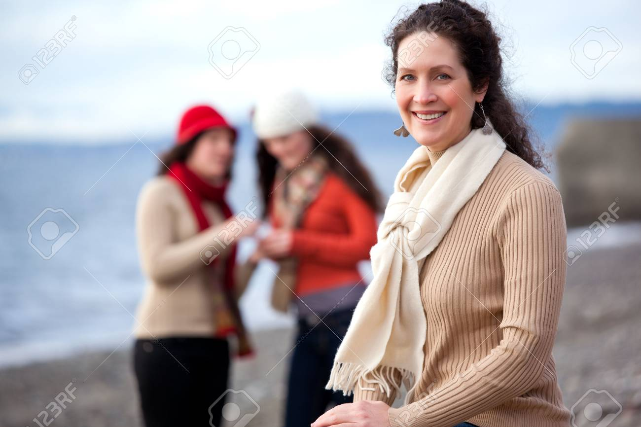 A portrait of a mother and her daughters on the beach Stock Photo - 6347746