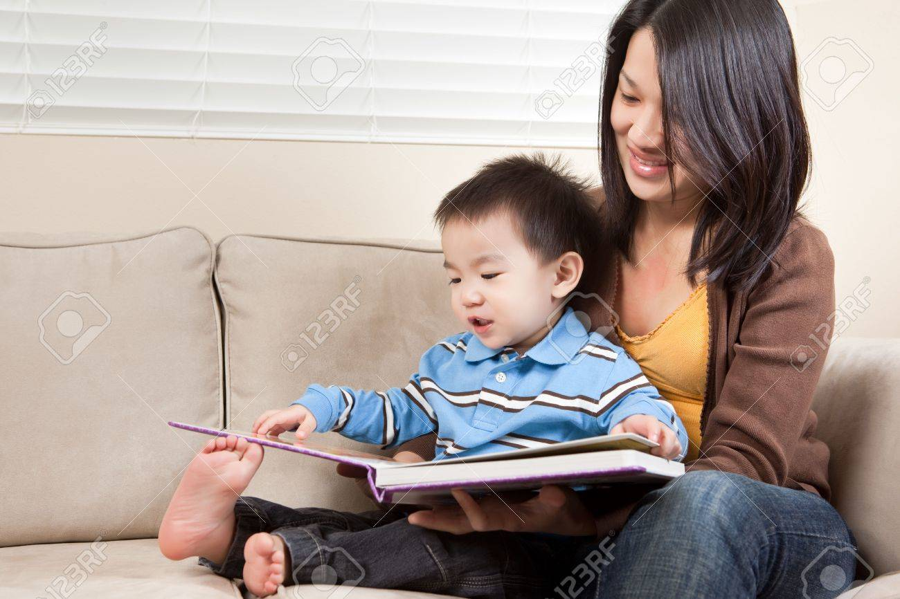 A portrait of a mother and a son reading a book Stock Photo - 6375349