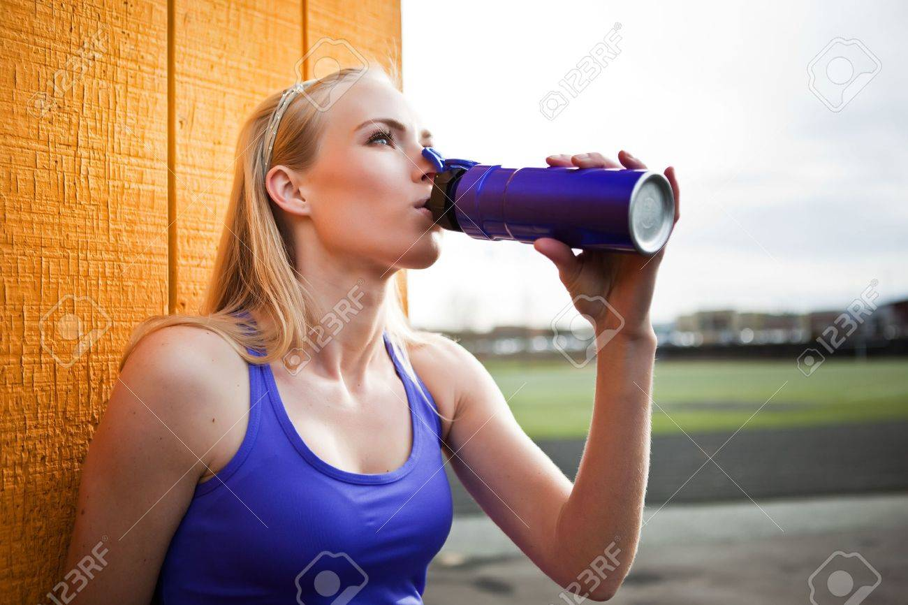 A portrait of a beautiful sporty caucasian woman  drinking water Stock Photo - 6645066