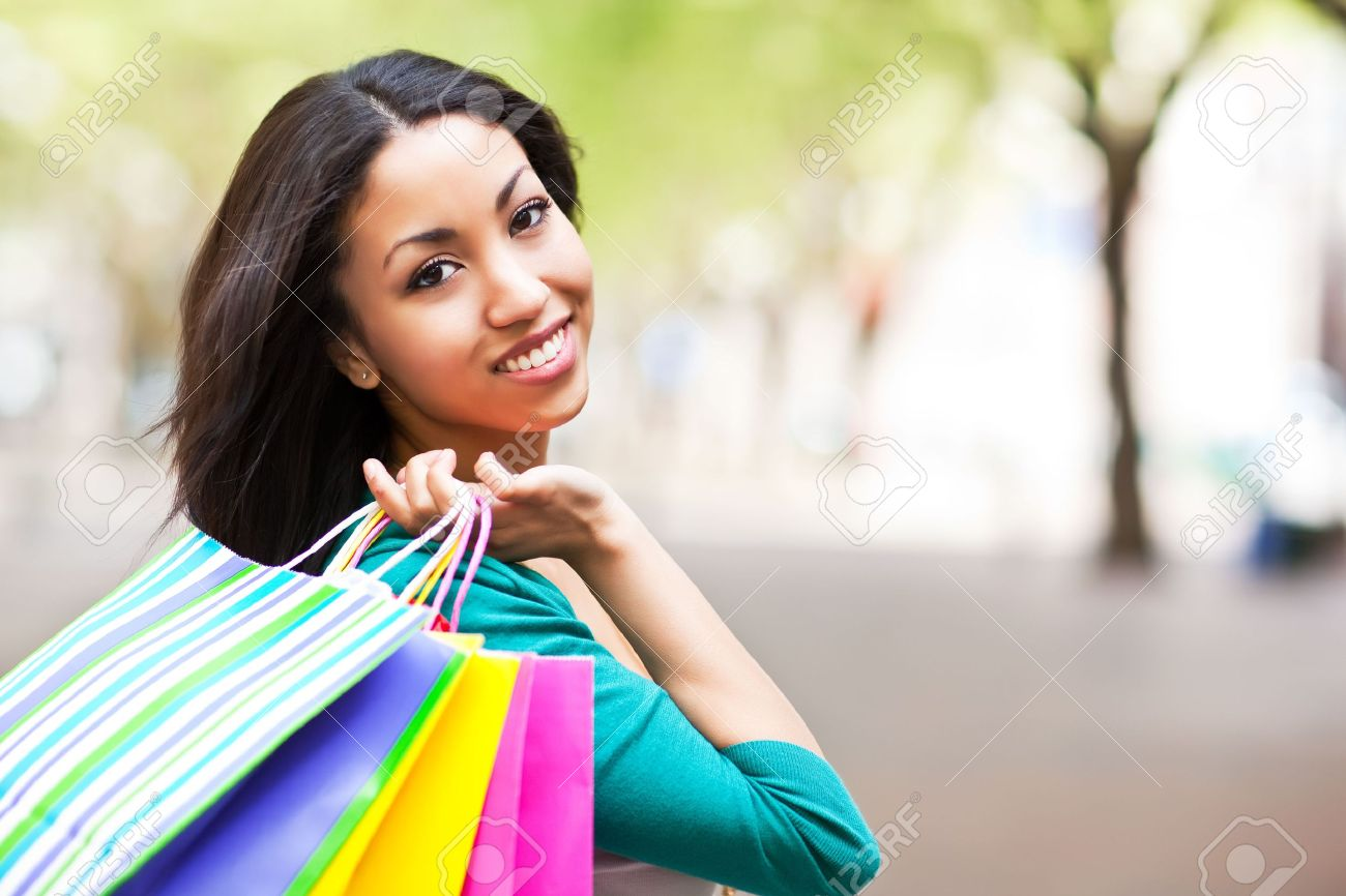 A shopping black woman carrying shopping bags outdoor Stock Photo - 7250053