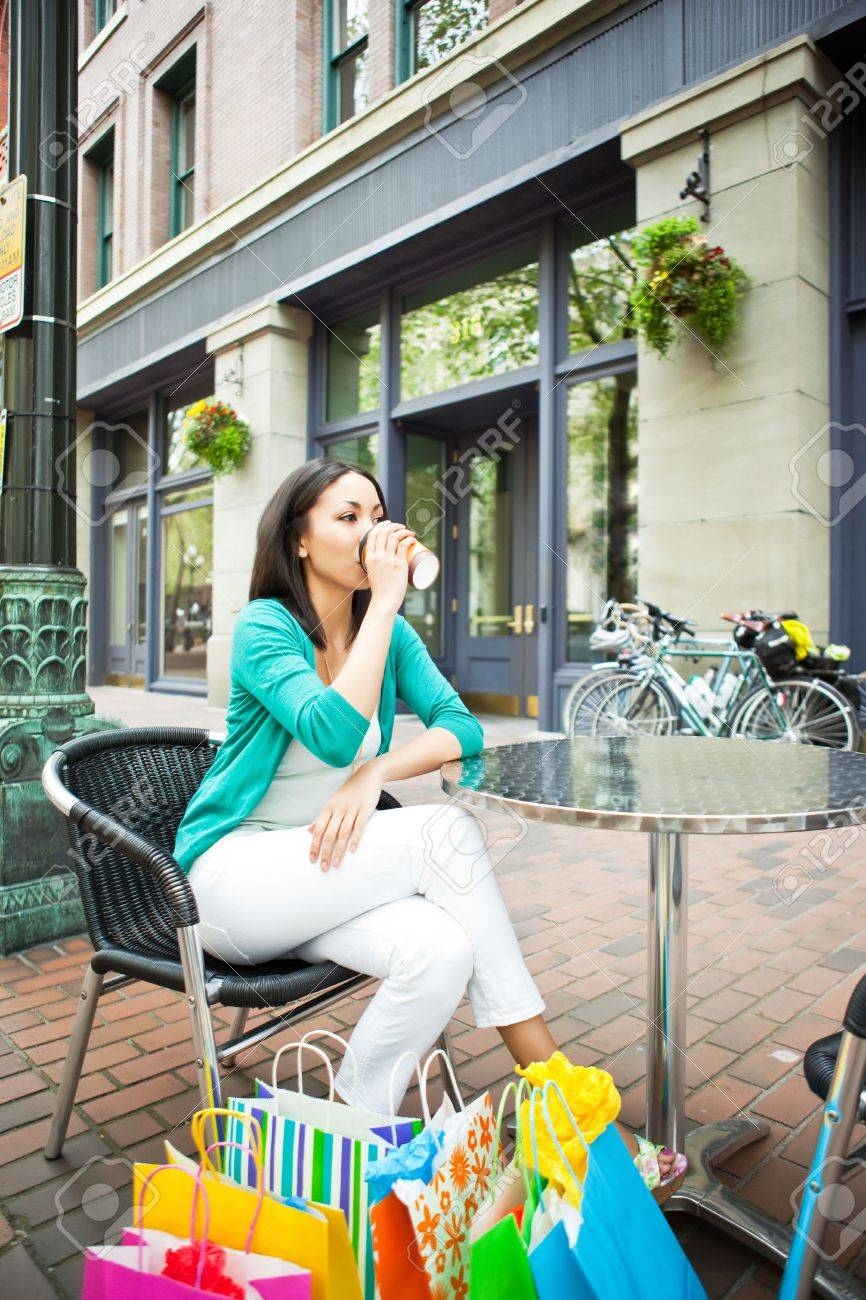 A shopping black woman resting at a cafe after shopping Stock Photo - 7250063