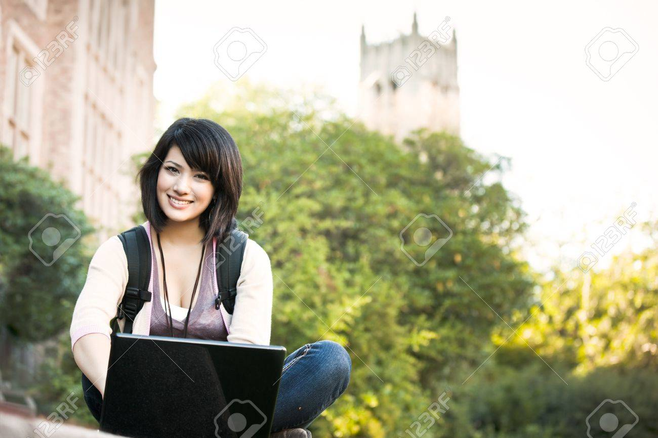 Mixed race college student working on laptop at campus Stock Photo - 7773575