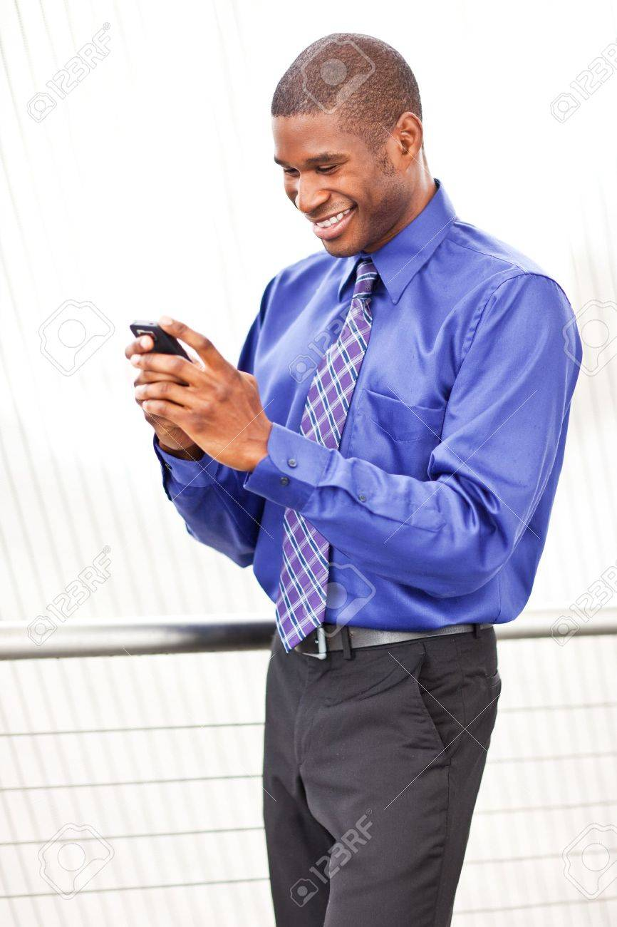 A shot of a beautiful black businesswoman texting Stock Photo - 7893660
