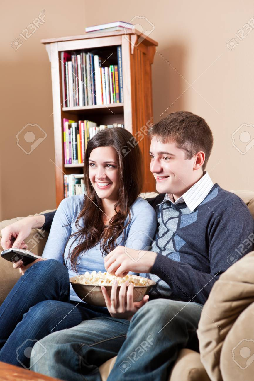A couple sitting on sofa and watching television Stock Photo - 8135785