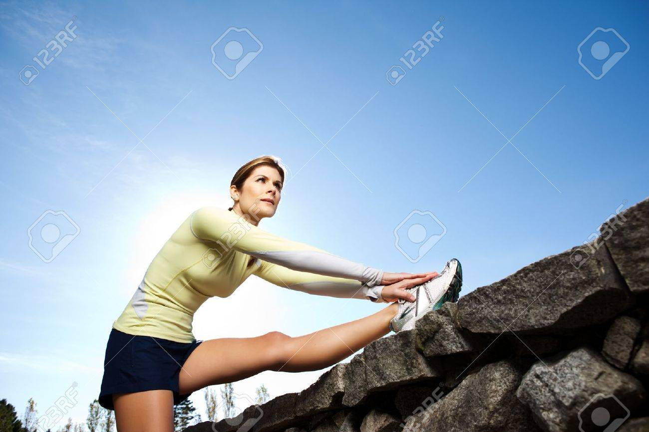 A beautiful caucasian woman doing exercise outdoor in a park Stock Photo - 8205433