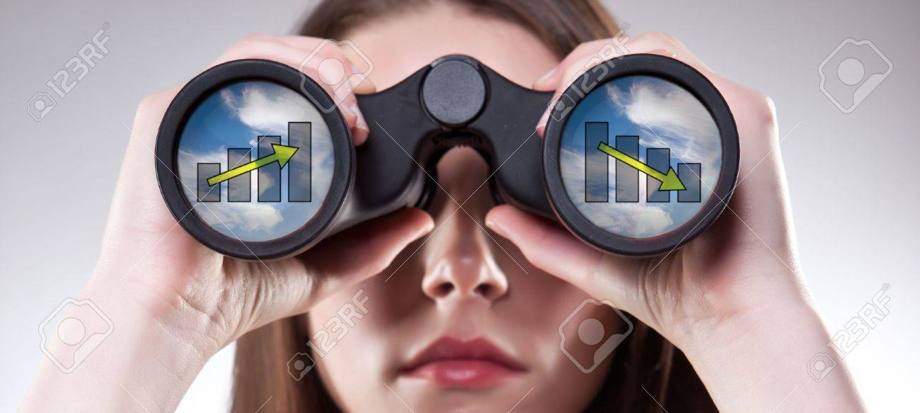A businesswoman looking through binoculars, seeing conflicting trends in earnings prediction, can be used for business vision or business prediction concept - 9075741