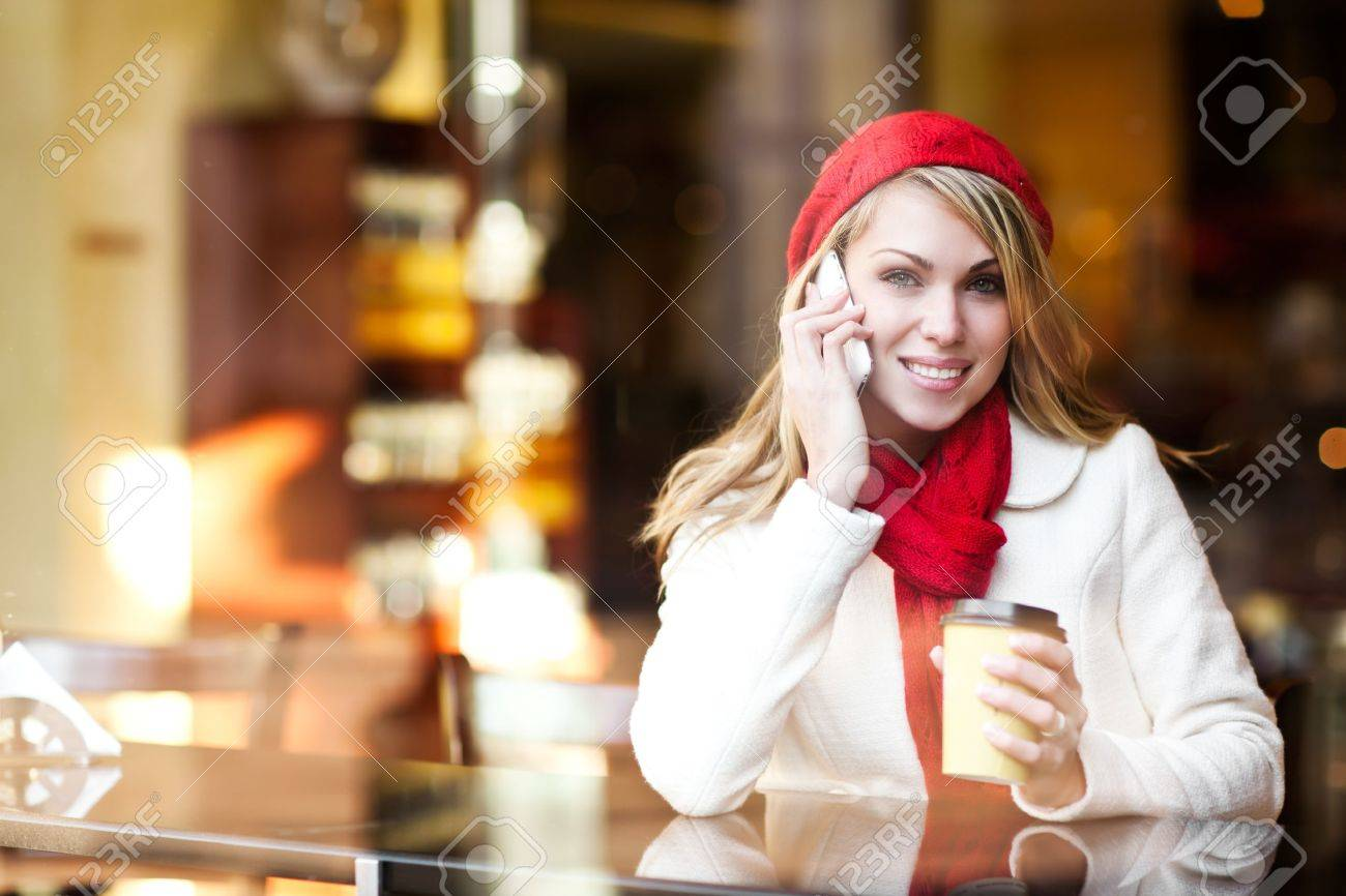 A shot of a beautiful caucasian woman talking on the phone at a cafe Stock Photo - 9154646