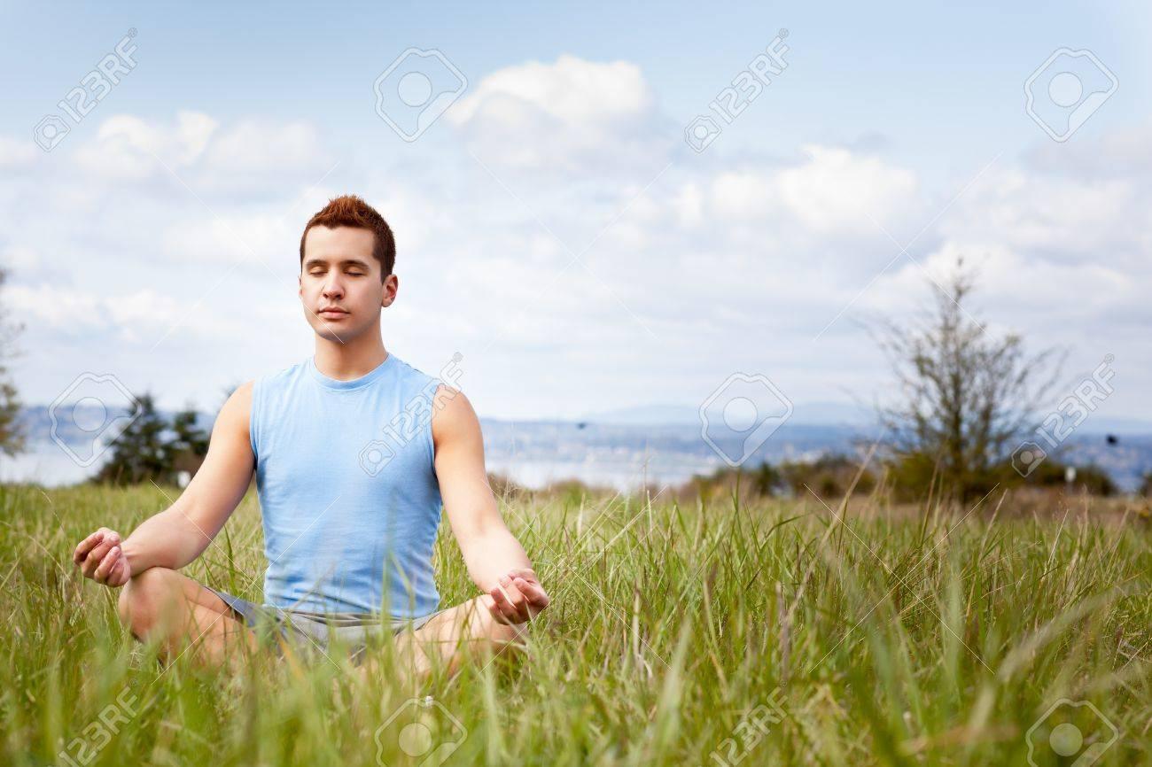 A shot of a mixed race man practicing yoga outdoor Stock Photo - 9597181