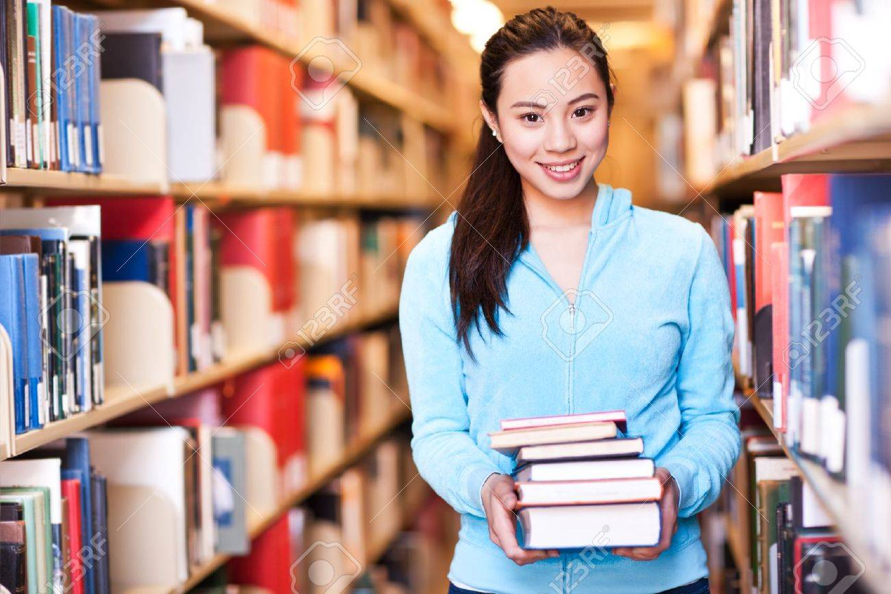 A portrait of an Asian college student studying in the library Stock Photo - 9748037