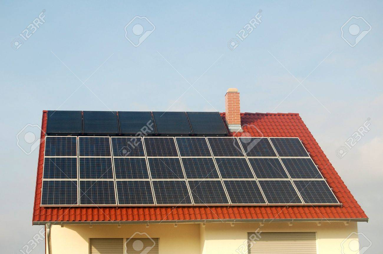 Solar panel and solar energy panel on a red roof Stock Photo - 3696129