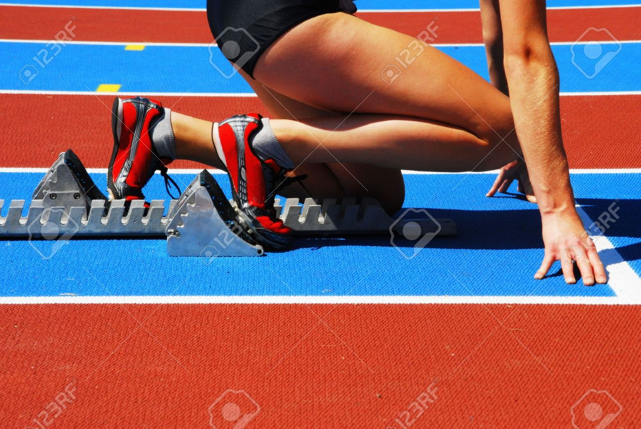 Woman in a starting block on an athletic field Stock Photo - 5061413