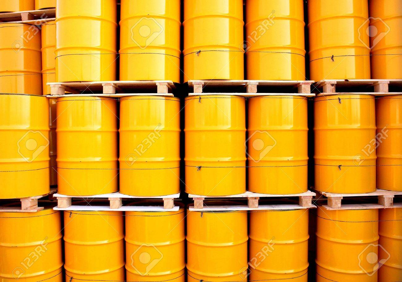 Yellow oil drums on an industrial transport site Stock Photo - 18800924