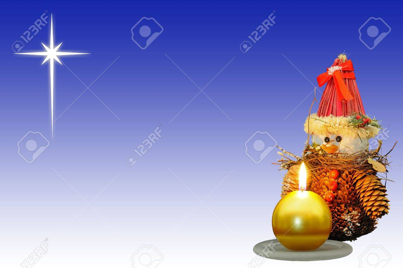 Pinecone snowman ornament with a gold candle in the foreground and the star of Bethlehem to the rear Stock Photo - 15217645