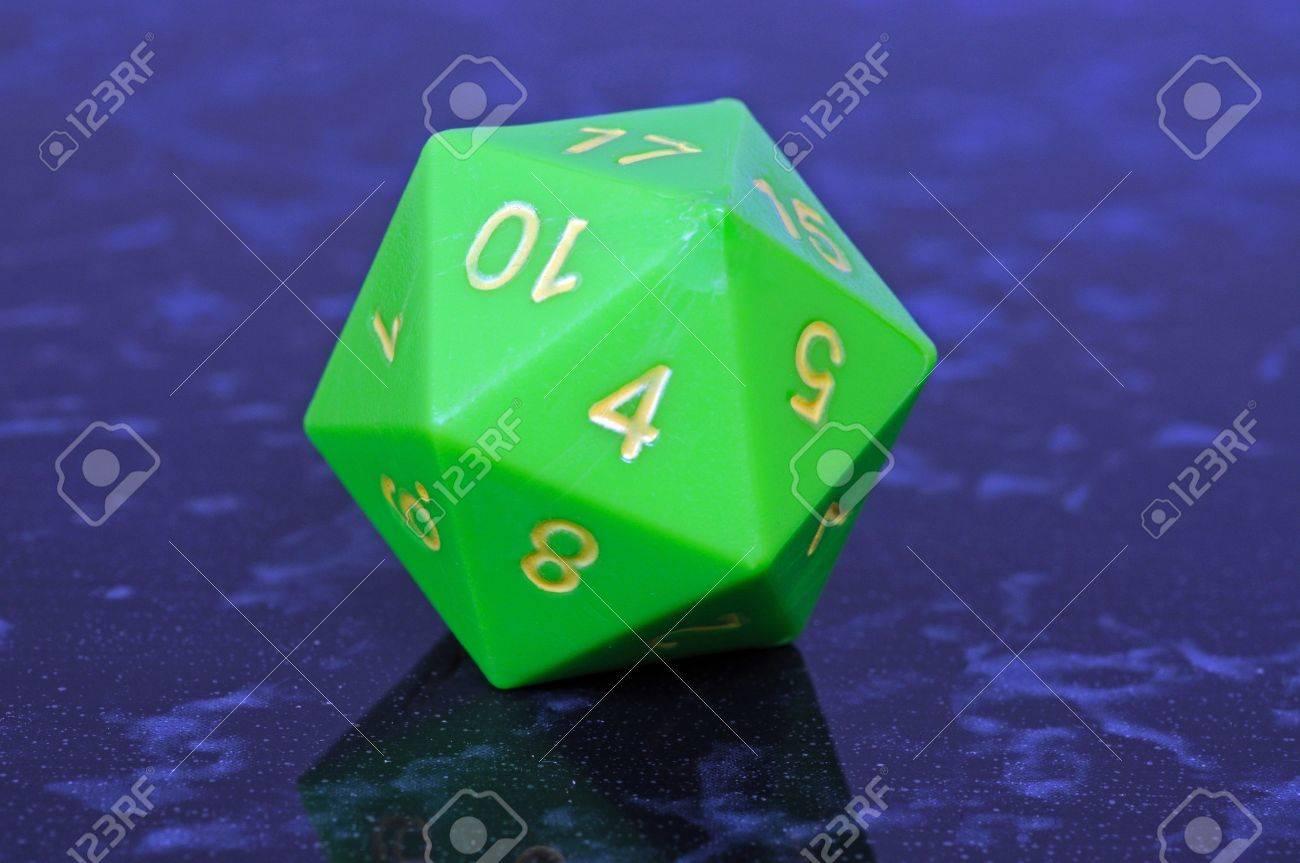 Green icosahedron 20 sided shaped numbered dice, England, UK,