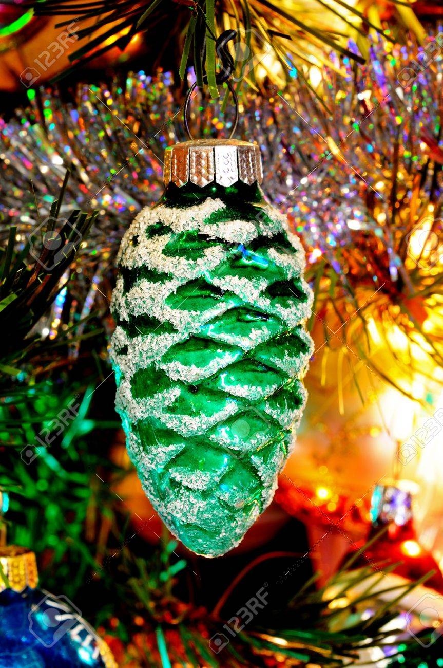 Green glass pinecone Christmas decoration hanging on a Christmas