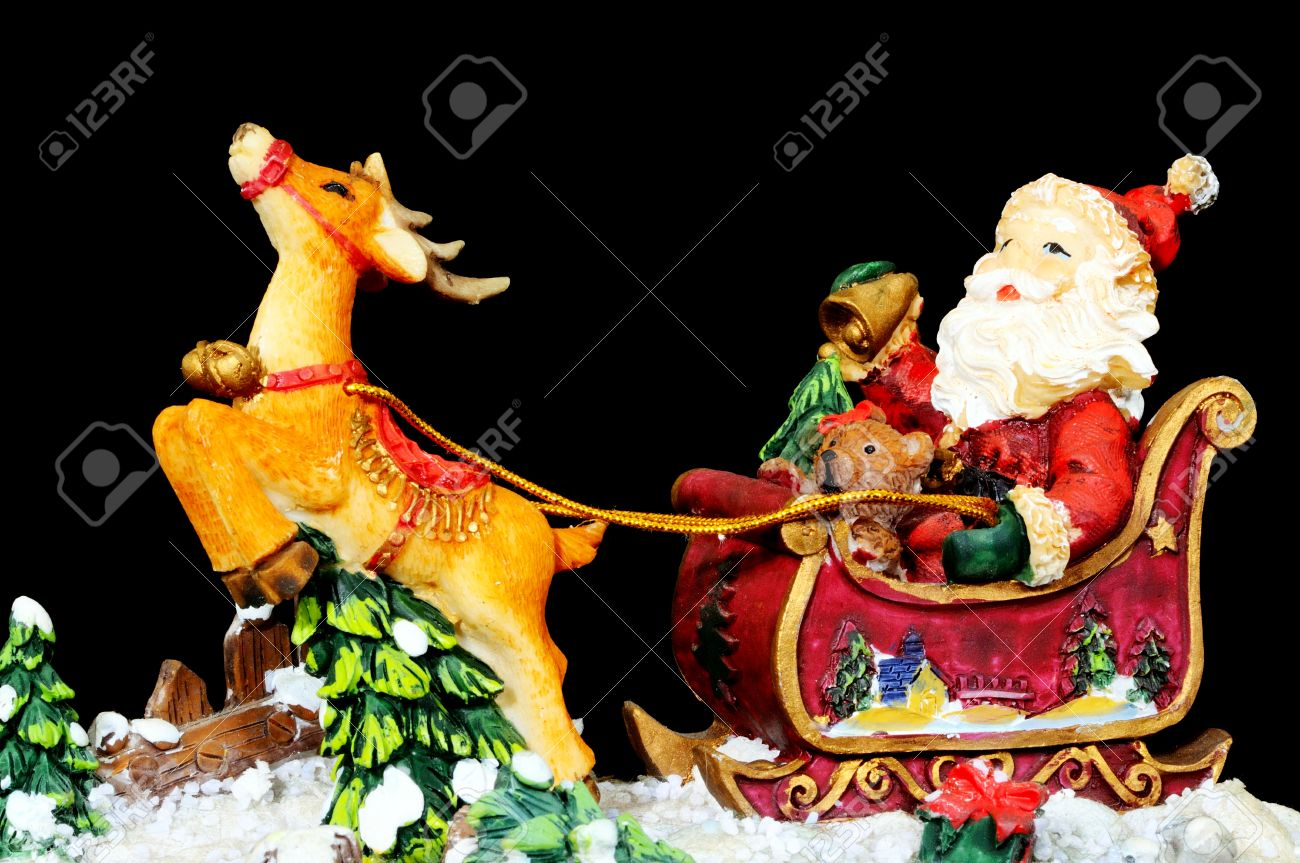 Ceramic Father Christmas In His Sleigh With Reindeer On A Black Background England UK