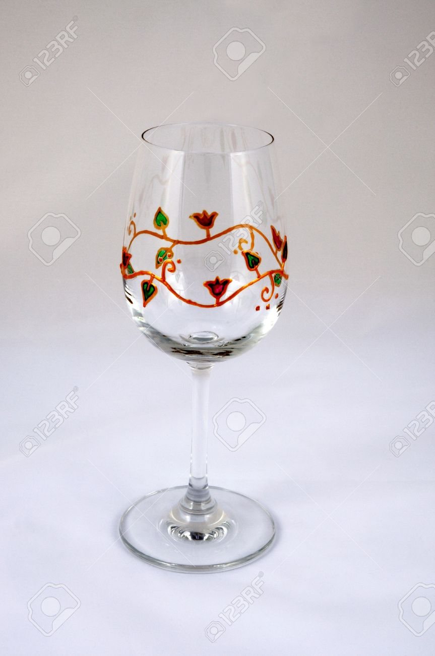 Hand Painted Wine Glass With A Red Green And Gold Floral Design