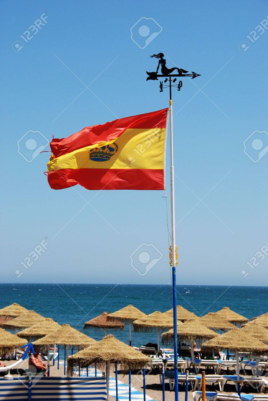 Flagpole with a spanish flag above parasols on the beach flagpole with a spanish flag above parasols on the beach benalmadena costa del sol sciox Image collections