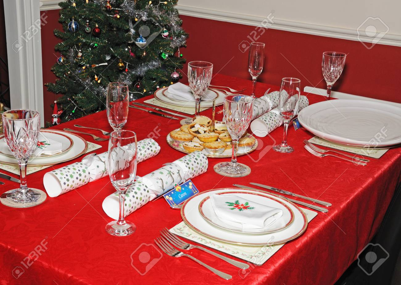 English Christmas table setting with mince pies in the centre and a Christmas tree to the & English Christmas Table Setting With Mince Pies In The Centre ...