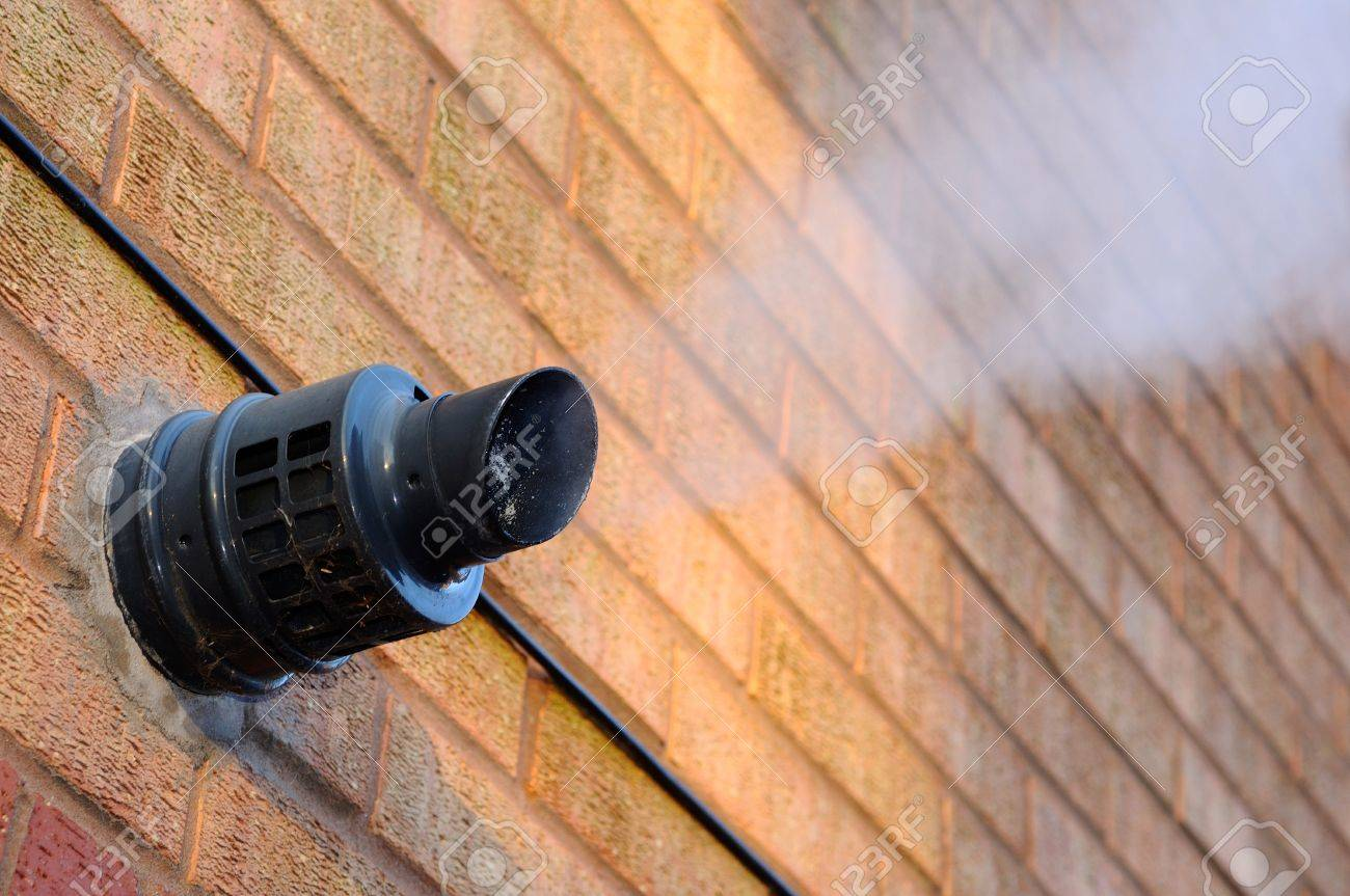 Steam Coming Out Of A Central Heating Flue On A House Wall, England ...