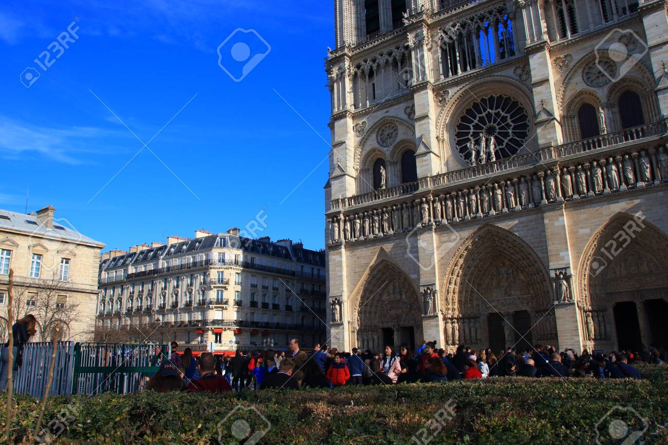 Notre Dame Cathedral in Paris and visiting tourists , France - 122540127