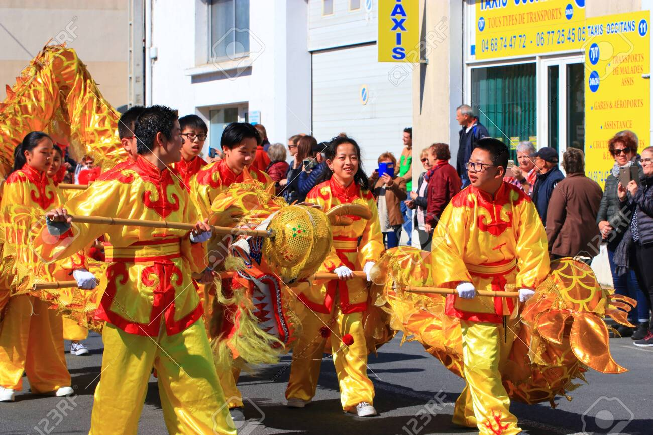 Asian parade with a dragon at the Limoux carnival in Aude, Occitanie in the south of France - 143985301