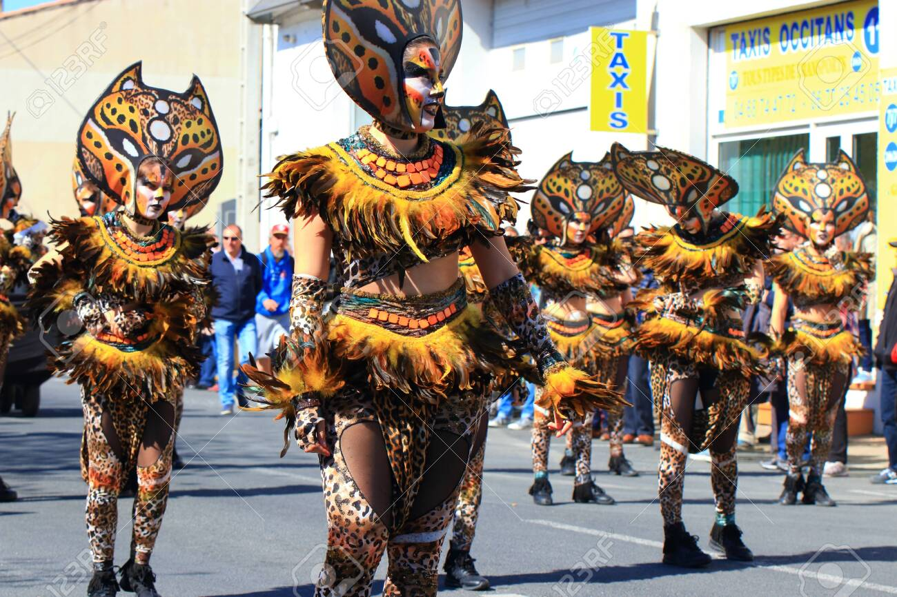 Disguised people parading at the Carnival of Limoux, Occitanie in the south of France - 143985308
