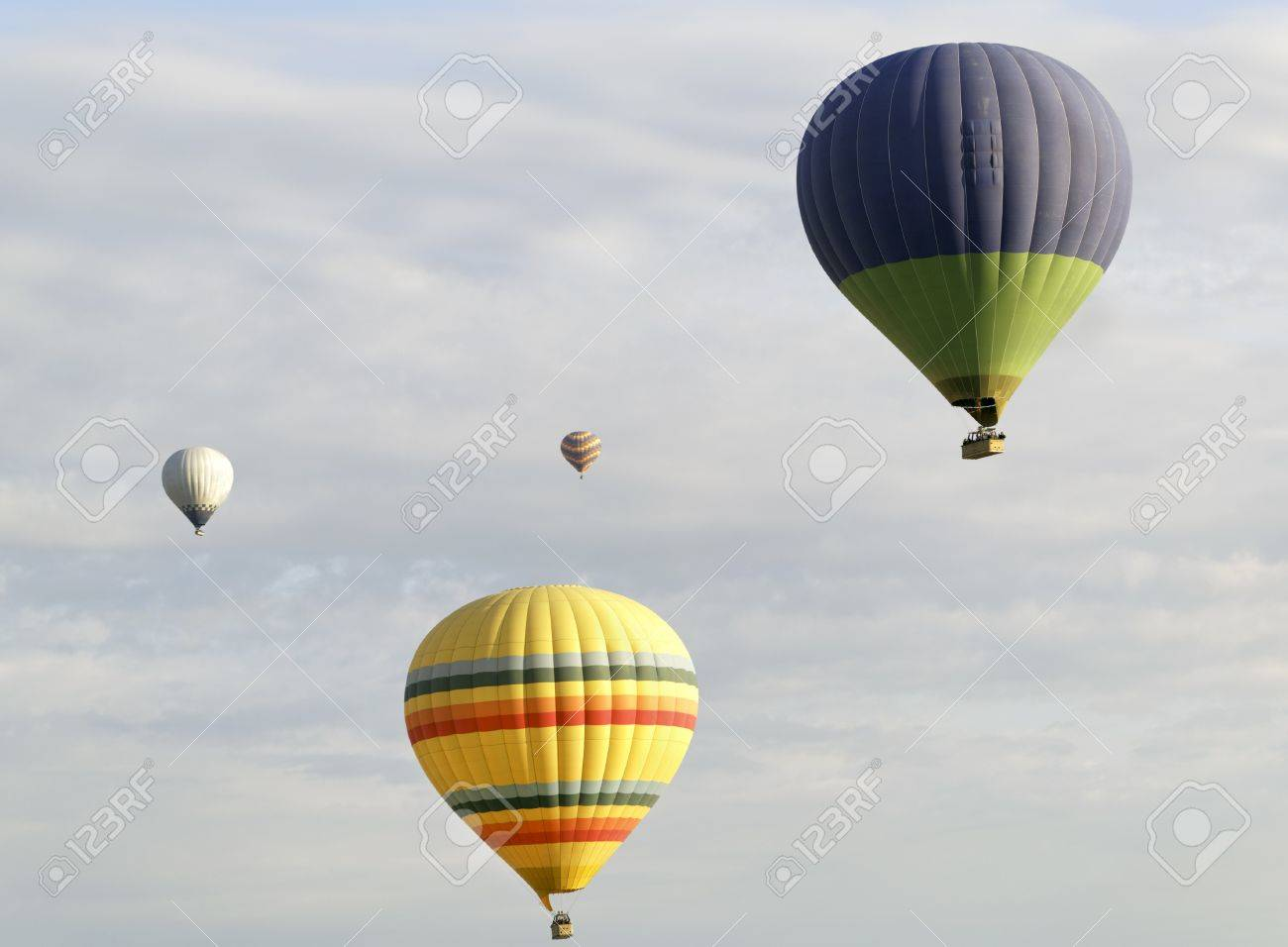 Horizontal Landscape Of Four Hot Air Balloons Amongst A Cloudy ...