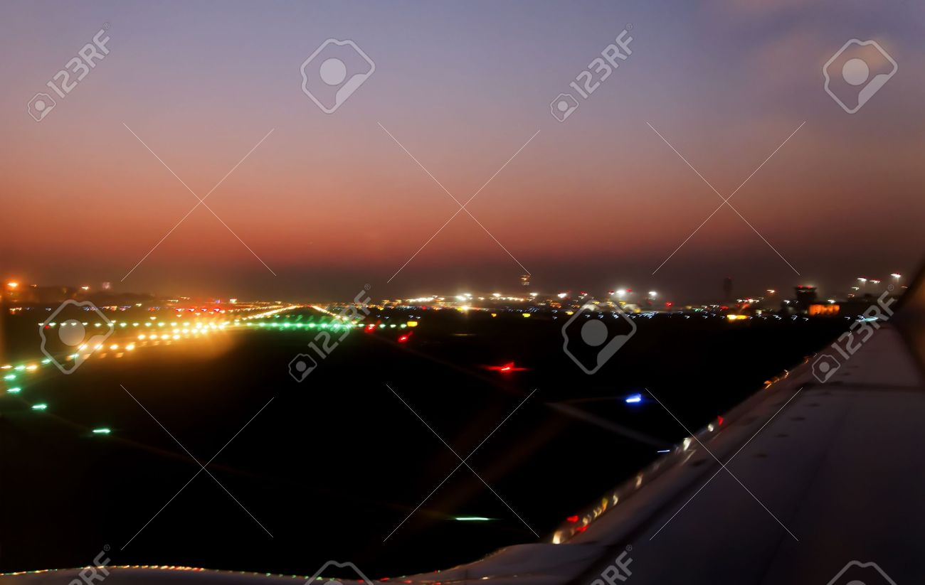 Horizon Landscape Of Night Time Runway Lights At Mumbai International  Airport During Take Off, Crop