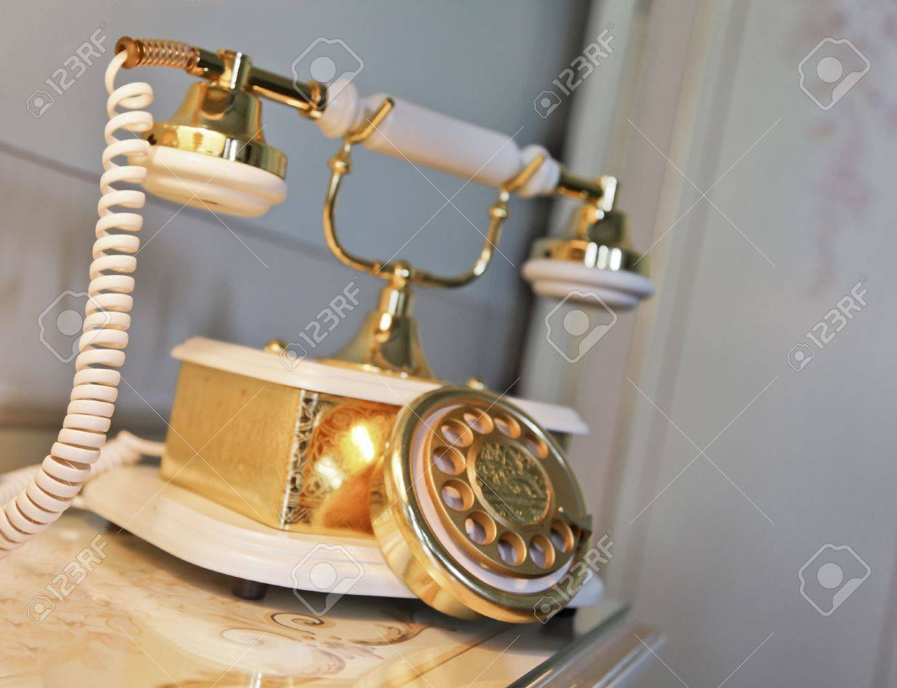 Interior Design Element Of Gold And Brass Creamic Telephone Retro Style On A Bedisde Table Stock