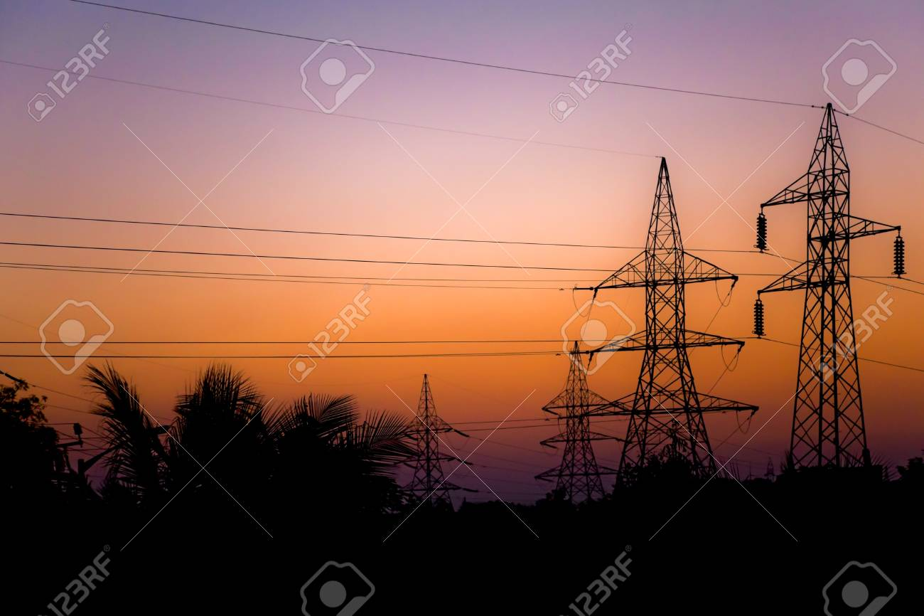 Generic Landscape Of National Grid Pileons And Stanchions Electrical Silhouetted At Dawn Shot Taken 6 Kilomteres From