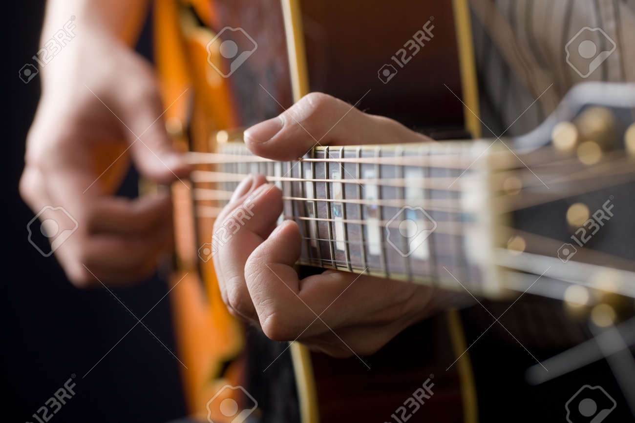 Hands of the playing guitarist close up Stock Photo - 6754644