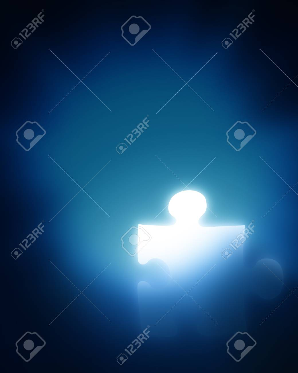 glowing puzzle piece on a blue background Stock Photo - 4199988