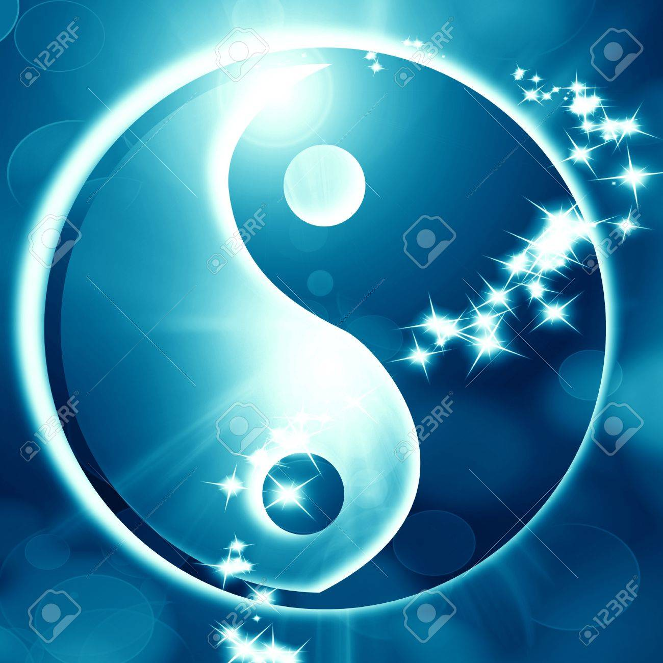 Yin Yang sign on a glowing background with some light rays Stock Photo - 15612672